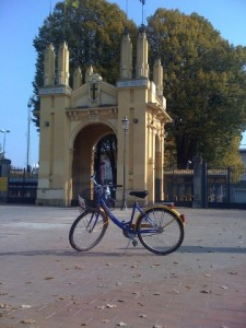 Rental Bike Posing for a Picture in Front of Stadium Entrance in Parma